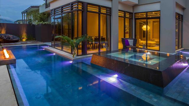 Sukabumi stone pool with raised spa with black granite